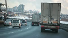 Autotrucks on the ring road in Russia - stock footage