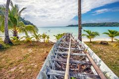 old thai boat at the beach - stock photo