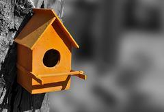 Orange bird house Stock Photos
