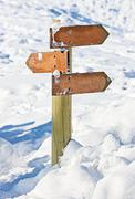 Old snow covered wooden signpost (index arrowhead) Stock Photos