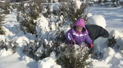 Mother and Child Playing in Snow, Throwing with Snow, Winter Season Stock Footage