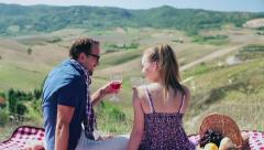 Couple drinking wine on picnic, crane shot - stock footage