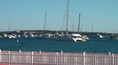 Boats and yachts float on the wavy waters of the sea Stock Footage