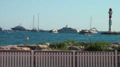 Yachts and boats float on the blue surface of the sea Stock Footage