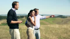 Real estate agent showing the property in the countryside married couple Stock Footage