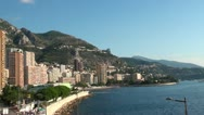 City built along the shore of the sea, at the foothill of a mountain Stock Footage