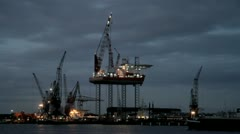 Derrick near Amsterdam in the Netherlands by night Stock Footage