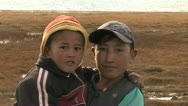 Kids possing in front of camera, Karakul Lake - Tajikistan Stock Footage