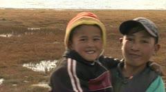 Kids possing in front of camera, Karakul Lake - Tajikistan Stock Footage