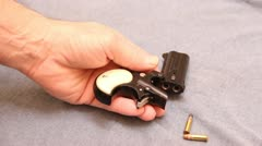 Loading a derringer Stock Footage