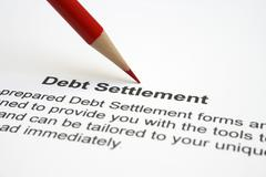 debt settlement - stock photo