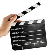 A hand holding a clapper board - stock photo