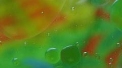 Oil-drops floating  in water Stock Footage