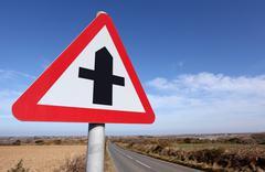 Crossroads ahead road sign warning. Stock Photos