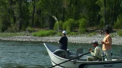 Mother and Son Fly Fishing on Yellowstone River Stock Footage