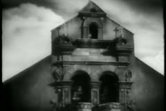 Wide shot of bells ringing in old church - stock footage