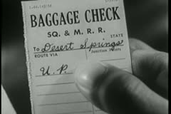 Close-up of  person holding baggage check ticket Stock Footage