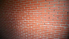 New built red brick wall, closeup view in upward motion Stock Footage