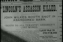 Stock Video Footage of Close-up of newspaper headline Lincoln's Assassin Killed
