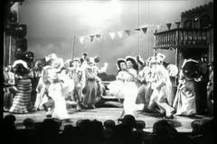 Dancers in costumes performing on stage Stock Footage