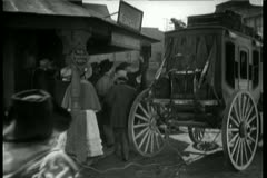 Horse carriage with rope attached loses wheels Stock Footage