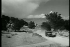 Pick-up truck speeding down country road Stock Footage