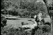 Native American falling from galloping horse during shootout Stock Footage