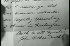 Close-up historical recreation of letter written by John Wilkes Booth - stock footage