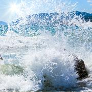 Sea surf wave and sunshine Stock Photos