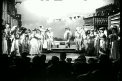 Stock Video Footage of Long shot of men wearing horse costume performing with female dancers on stage