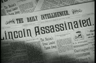 Stock Video Footage of Close-up of  Lincoln Assassinated headline