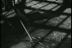 Prisoner using a stick to retrieve keys to cell - stock footage