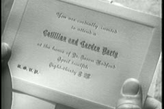 Close-up of person holding invitation card Stock Footage