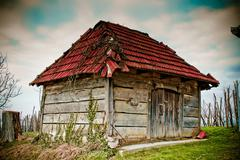 Stock Photo of old wooden cottage - traditional wine cellar