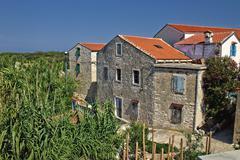 dalmatian architecture, island of susak - stock photo