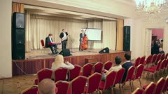 Musicians trio play music on stage during PolitProsvet award Stock Footage