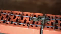 Metalware lattice on brick wall under construction, closeup Stock Footage