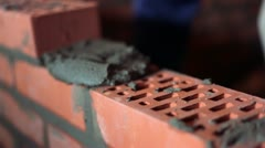 Brickwork process with trowel, closeup view - stock footage