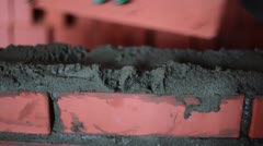 Worker with trowel during brickwork, closeup view - stock footage