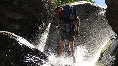 Rappelling down a waterfall.JPG - stock photo