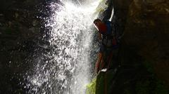 Rappelling Down A Waterfall (2).jpg - stock photo
