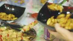 Hands put food in plates on holiday table, closeup view Stock Footage
