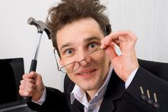 The insane man with a hammer in a hand Stock Photos