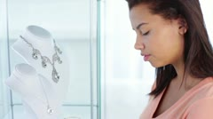 Attractive African-American Young Woman Looking at Jewelry Close Up Stock Footage