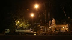 Oil well at night Stock Footage