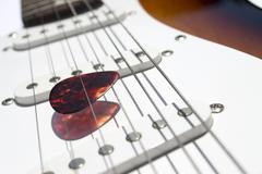 Plectrum among strings Stock Photos