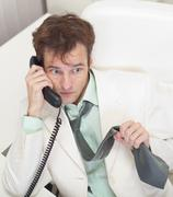 Men worries speaking by phone with chief Stock Photos