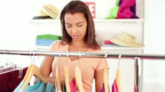 Attractive African-American Young Woman Clothes Shopping at Clothing Rack - stock footage