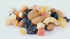 Handful of nuts, dried fruits and candied fruits circling Stock Footage
