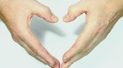 Man senior hands show heart gesture with shadow Stock Footage